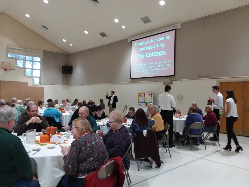 Photo of guests enjoying being served by the youth for the 2018 Beef Stroganoff Dinner